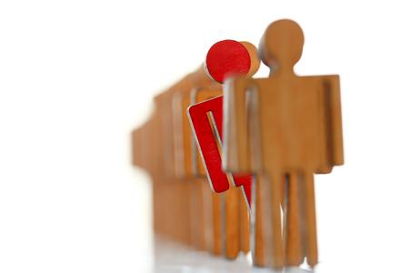 Männliche rote Plastikspielzeuggeschäftsmannsilhouette