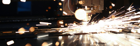 Sparks fly out machine head for metal processing Фото со стока