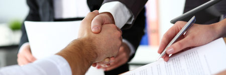 Man in suit and tie give hand as hello in office closeup Reklamní fotografie