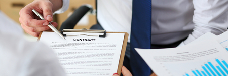Male arm offer contract form on clipboard pad