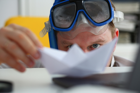 Man wearing suit and tie in goggles and snorkel