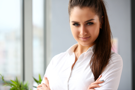Beautiful smiling girl at workplace look in camera Stock Photo