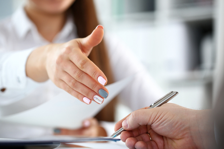Woman in suit give hand as hello in office closeup