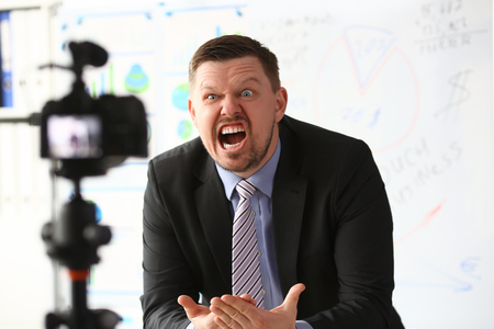 Businessman blogger online couch screaming Stock Photo