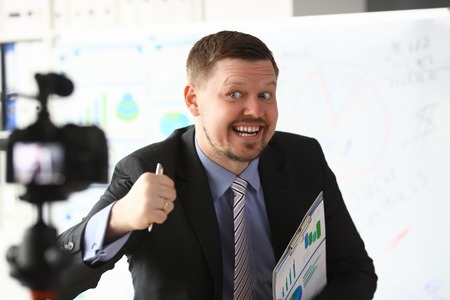 Businessman blogger online couch screaming Фото со стока