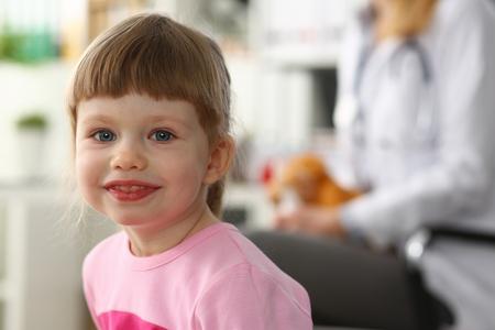 Cute little girl visiting family doctor office