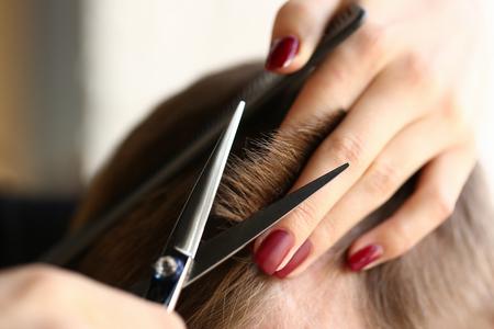 Female hand hold hair scissors hairdresser