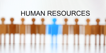 Human resources sign above line of toy human figures