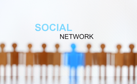 Social network sign above line of toy human figures