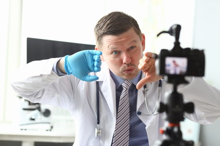 Male vlogger doctor look at camera