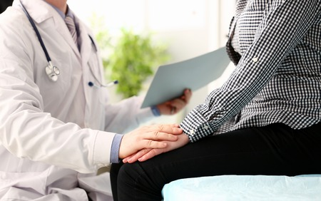 Male doctor hold pacient female arm