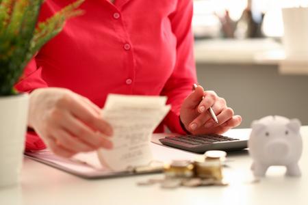 Female hand financial inspector push key