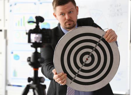 Male millennial vlogger hold target darst