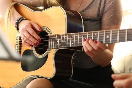 Female hands holding and playing western