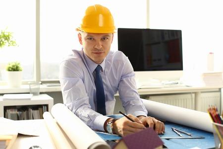 Young Architect Freelance Man Working on Blueprint