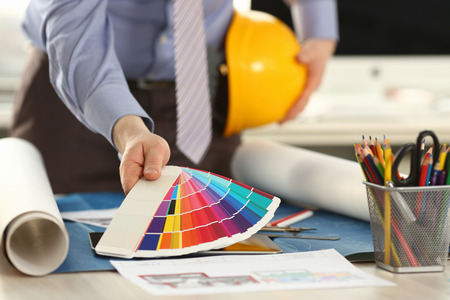 Architect Holding Spectrum Color Palette at Office Stockfoto - 121062783