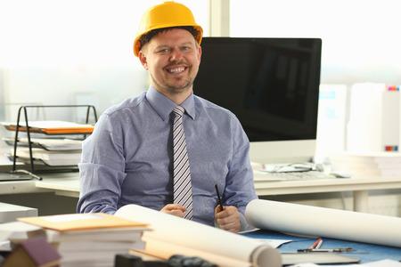 Joyful Architect Sketching Building Blueprint