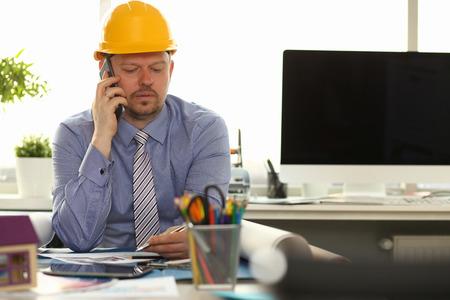 Caucasian Engineer Working on House Blueprint Stockfoto