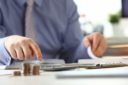 Man with Ring Calculate Revenue Tax Report Concept Stockfoto