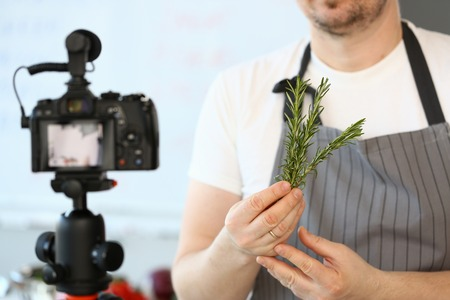 Man Blogger Showing Rosemary Bundle Ingredient