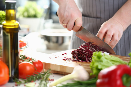 Professional Chef Hands Slicing Purple Cabbage Imagens