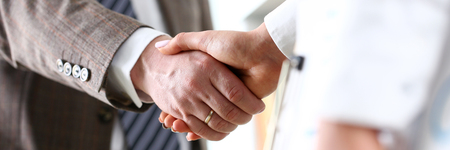 Man in suit and tie give hand as hello in office closeup. Friend welcome mediation offer positive introduction thanks gesture summit participate executive approval motivation male arm strike bargain