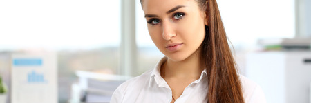 Beautiful smiling girl at workplace look in camera portrait. White collar dress code worker at workspace job offer modern office lifestyle client visit study profession boss market idea coach train