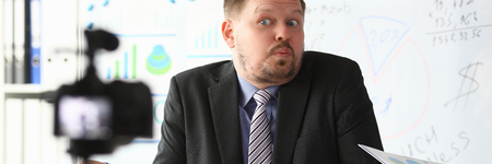 Businessman uncertain blogger online coach screaming intro camera bad news concept Stock Photo