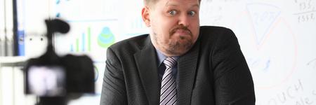 Businessman uncertain blogger online coach screaming intro camera bad news concept