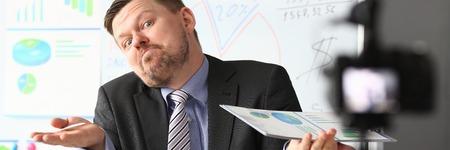 Businessman uncertain blogger online coach screaming intro camera bad news concept Фото со стока