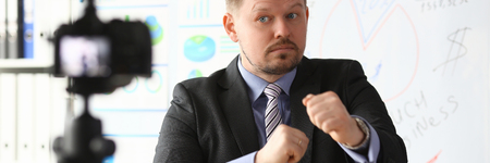 Businessman blogger boxing online coach screaming intro camera concept