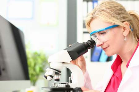 Laboratory Doctor Analyzing Microscope Research