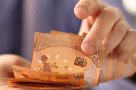 Busy Man Counting Euro Savings Finance Concept
