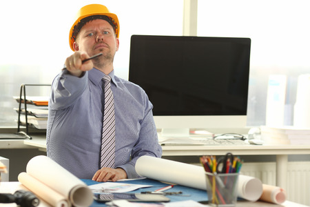 Serious Architect Working on Construction Outline