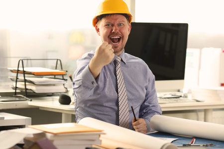 Architect Working on Building Blueprint at Office Stockfoto