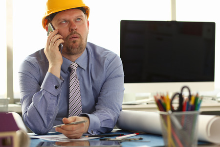Construction Worker Sit in Engineering Office