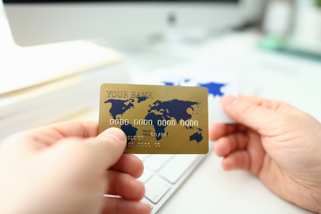 Male hand hold plastic bank card aganist