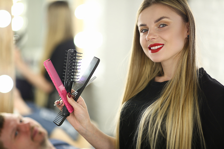Professional Female Hairstylist with Hairbrush