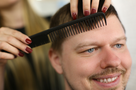 Making Haircut for Man Client in Barbershop Salon Stock Photo