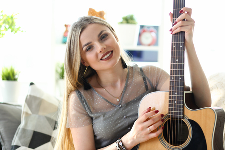 Caucasian Female Musician Playing Music at Home