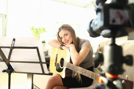 Pretty Blogger Creating Musical Video Workshop Stock Photo