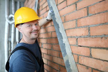 Smiling construction master Stock Photo