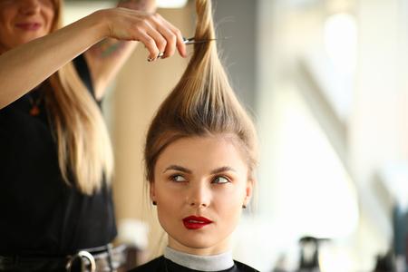 Hairdresser Cutting Hair to Blonde Woman Portrait