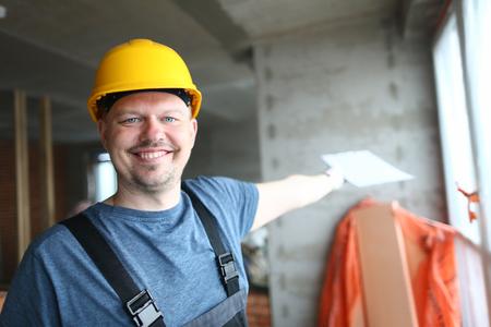 Happy guy demonstrating front of work Stockfoto