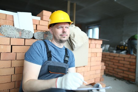 Concerned man in hardhat Stock Photo