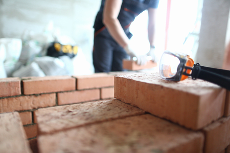 Skilled bricklayer working