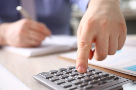 Businessman Calculate Finance Budget Press Button Stockfoto