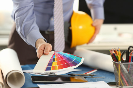 Architect Holding Design Color Swatch at Office Stockfoto