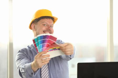 Portrait of Happy Male Designer Hold Color Palette