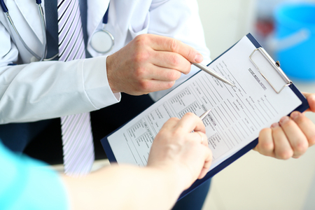 Doctor colleagues discussing documents